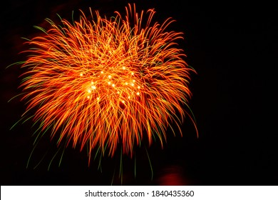 Night sky with fireworks display brilliant thick upper left corner