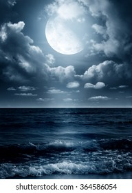 Night sky with full moon and reflection in sea. Elements of this image furnished by NASA