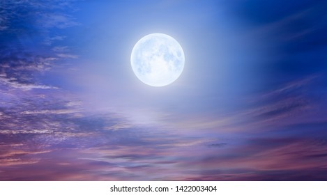 """Night sky with moon in the clouds at sunset """"Elements of this image furnished by NASA"""