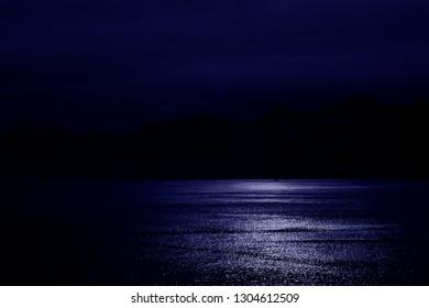 Night Sky and Moonlight over sea