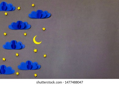 Night sky origami craft composition with copy space on right side. Creative composition for banner/landing page/background