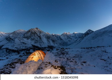 night sky over Belukha Mountain. Tent in the snow in the winter on the mountain elephants.