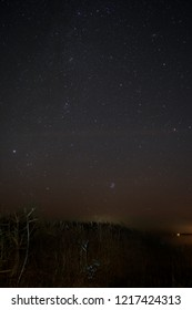 Night Sky over Fischland in Germany with Milky Way, Pleiades, Andromeda Nebula, and Perseus Constellation