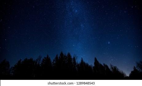 Night sky over rural landscape. Beautiful night starry sky landscape.