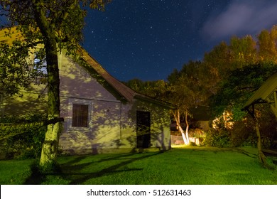 Night sky over the small house in the summer