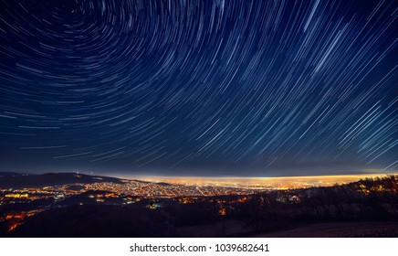 Night sky star trail over the city