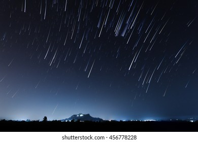 night sky, star trails and the mountain with long exposure stacking, soft focus
