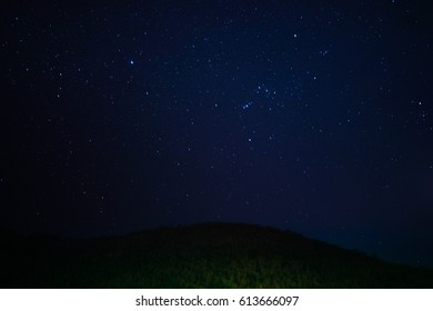 Night sky with stars and mountain