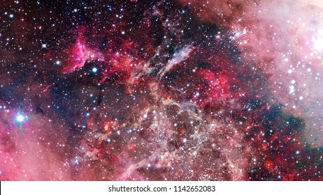 Night sky with stars and nebula. Elements of this image furnished by NASA.