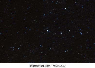 Night sky stars out of focus, constellation Cassiopeia