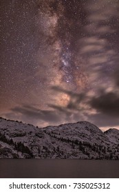 Night sky stars over Banner Peak above Garnet Lake in the Ansel Adams wilderness after a fresh snow