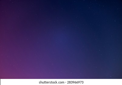 Night sky with stars with purple tint, gradient