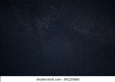 Night sky with stars and sattelites