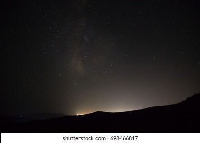 Night Sky stars with a white light tint from the city in the horizon, in Ermioni area, Greece