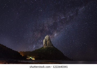 night sky stars whith some clouds in fernando de noronha, pernambuco - brazil