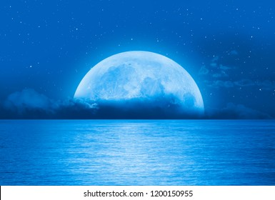 "Night sky with Super full moon in the clouds ""Elements of this image furnished by NASA"