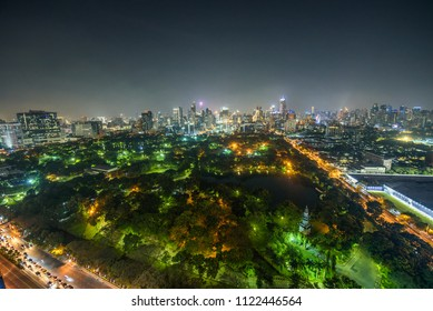 Night skyline of midtown Bangkok with Lumphini Park in the foreground