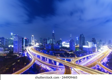 Night skyline view of Shanghai city and highways with flowing traffic