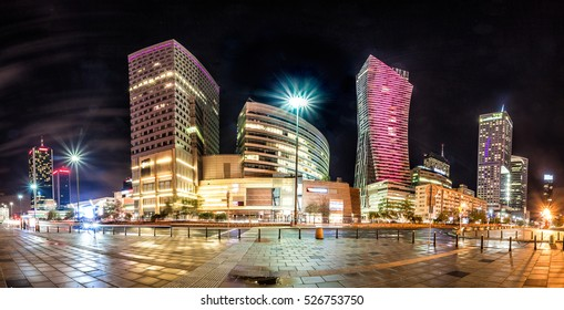 Night skyline of Warsaw with soviet era Palace of Culture and science and modern skyscrapers. Panoramic montage from 10 images
