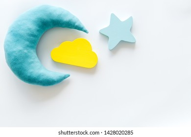 Night sleep concept with moon, stars, cloud toy on white background top view mockup