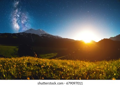 Night starry landscape of Mount Elbrus at sunset of the moon