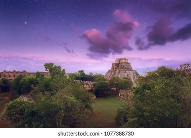 Night starry sky over the ancient Mayan city of Uxmal in Mexico