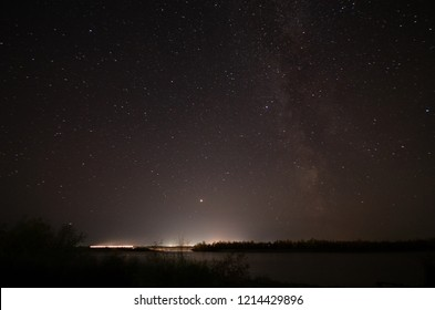 Night starry sky over the Irtysh River in the Omsk Region