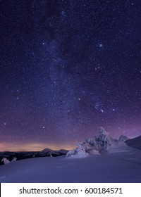 Night starry sky in winter mountains