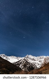 Night stars over snow alps mountain in italy bardonecchia winter time wall paper for phone iphone cellphone