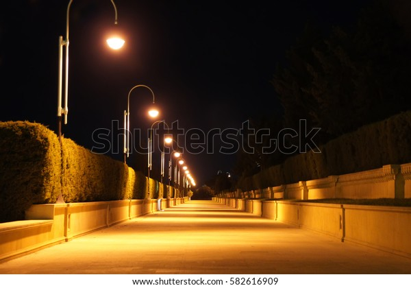Night street light. Evening Night Dark street light. Walking on empty street. Empty city alley light. Walk alone empty alley view. Suspense situation, insecure situation empty dark alleyway