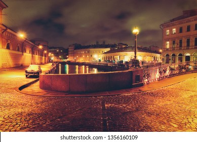 Night street in the old town, bridge, paving, vintage car, yellow lights