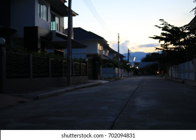 night street in residential house building village suburb , image blur background