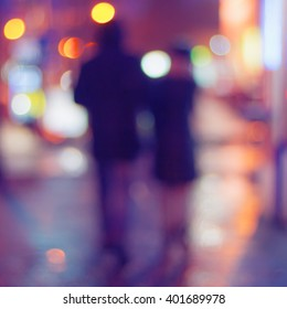 Night Street and silhouettes of people, blurred background