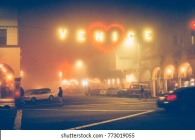 Night street and Venice Beach sign in Los Angeles, California