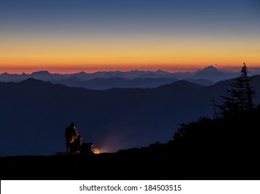 NIght time camping on a mountain top with a beautiful sunset view