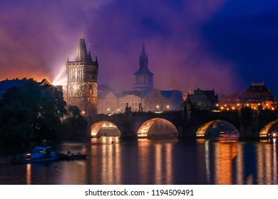 Night time hazy smoke over the charles bridge in prague after fireworks
