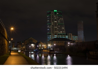 A night time image of the building in Leeds locally nicknamed the 'dalek' building, taken from the canal at Granary wharf
