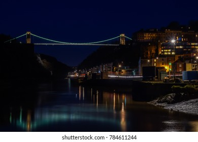 Night time long exposure of the Avon Gorge and Clifton Suspension Bridge in Bristol. Lights illuminate the bridge and city.
