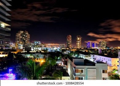 Night time in Miami Beach with the city of Miami, Florida in the distance.  This is a unique view of this cityscape.