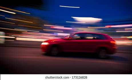 Night time panning shot of a Red Audi A3