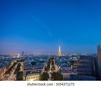 Night time in Paris with Eiffel tower and Montparnasse