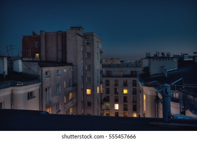 Night time photo of city rooftops. Warsaw, Poland urban rooftop photo.