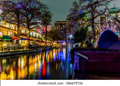 Night Time Scenic View of the Historic Texas Riverwalk with Christmas Lights on a Rainy Night in San Antonio, Texas.
