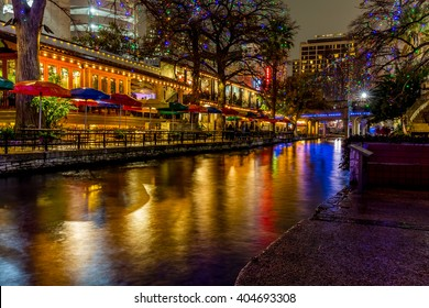 Night Time Scenic Views of the Riverwalk with Christmas Lights on a Rainy Day at San Antonio, Texas.