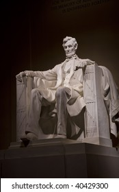 A night time shot of Abraham Lincoln's statue inside the Lincoln Memorial. Located on the National Mall in Washington DC.