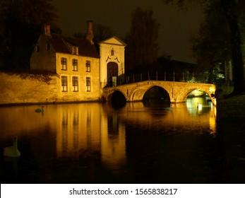 Night time shot of the bridge into the Ten Wijngaerde and Begijnhof in Brugge / Bruges - Belgium.