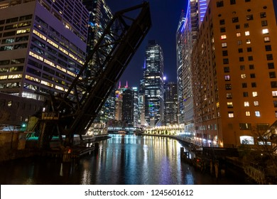 Night time shot of the disused Kinzie Street rail bridge over the North Branch of the Chicago River.