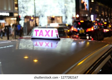 Night time taxi on HongKong streets blured background photo