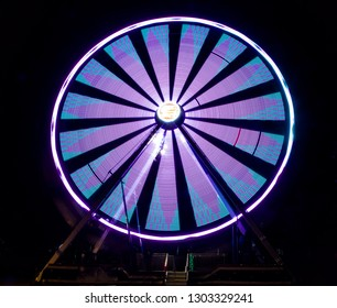 Night Time View of a Ferris Wheel