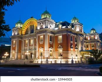 Night time view of illuminated Osaka Central Public Hall in Osaka city Japan
